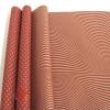 Крафт бумага двухсторонняя. Горох тонировка ВОЛНА  красный на коричневом 70 см х 8,5 м